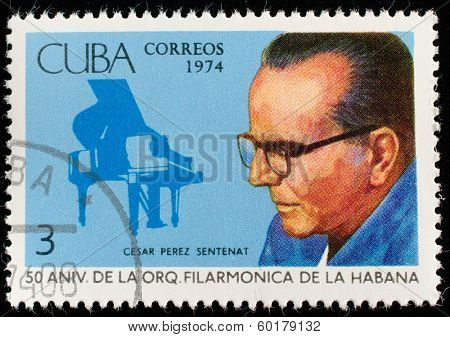 CUBA - CIRCA 1974: a stamp printed in the Cuba shows Cesar Perez Sentenat, Piano, Havana Philharmonic Orchestra, 50th Anniversary, circa 1974