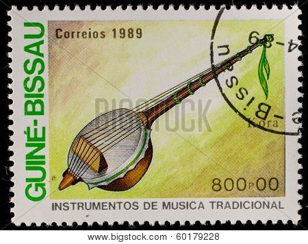 GUINEA - CIRCA 1989: A stamp printed in GUINEA shows Traditional Musical Instruments (kora), circa 1989