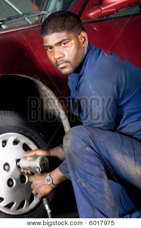 Mechanic changing tyre