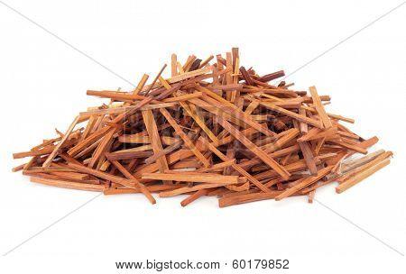 Sappan wood used in chinese herbal medicine over white background. Su mu. Caesalpinia.