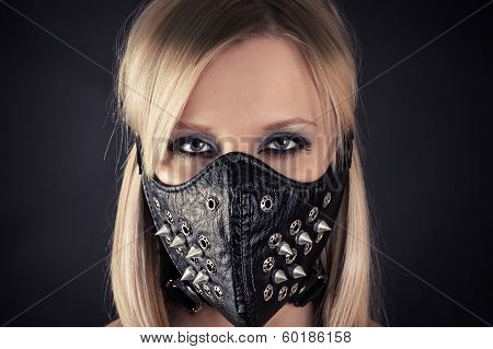 woman in a mask with spikes