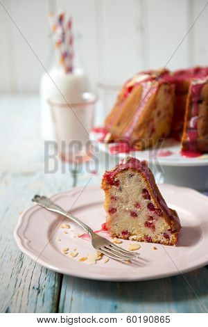 A Slice Of Cake On Plate With Fork And Fresh Milk