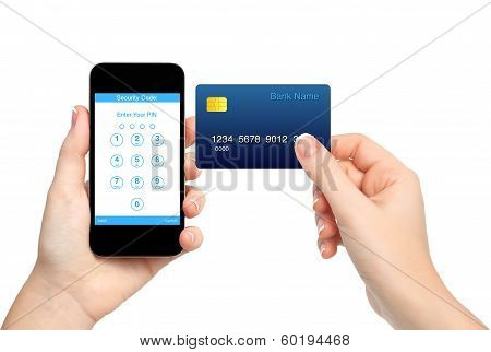 Isolated Female Hands Holding Phone And Credit Card And Enter A Pin Code