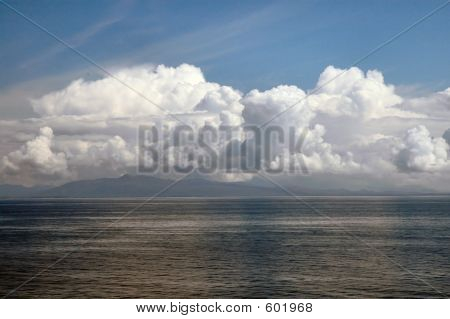 Billowing Clouds On Ocean At Sunset