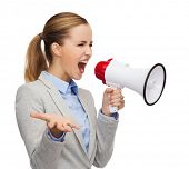 business, communication and office concept - angry businesswoman with megaphone