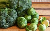 picture of brussels sprouts  - Broccoli and brussell sprouts on a cutting board - JPG