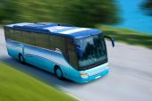 stock photo of bus driver  - A blue bus traveling on a highway - JPG