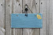 Blank antique blue sign with iron keys and gold hearts