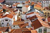 The medieval Alfama District orange rooftops seen from the Santa Luzia Belvedere. Lisbon, Portugal.