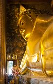 picture of recliner  - Reclining Buddha gold statue - JPG