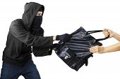 picture of delinquency  - Thief stealing handbag from a woman - JPG