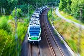stock photo of high-speed train  - Scenic summer view of modern high speed passenger commuter train on tracks with motion blur effect - JPG