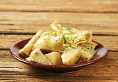 stock photo of artichoke hearts  - artichoke hearts marinated in oil - JPG