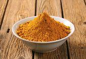 stock photo of garam masala  - bowl of curry powder - JPG