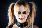 stock photo of harlequin  - portrait of a woman in the image of the mad a harlequin - JPG