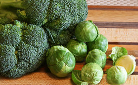 image of cruciferous  - Broccoli and brussell sprouts on a cutting board - JPG