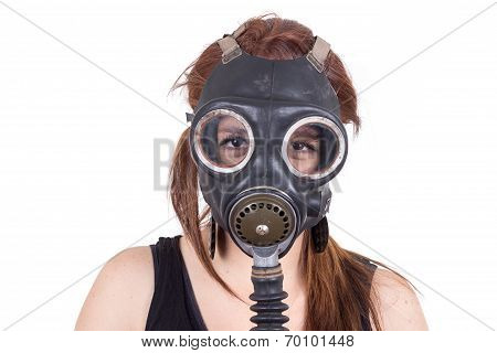 Young girl wearing gas mask
