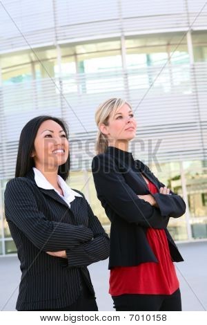 Pretty Business Women At Office