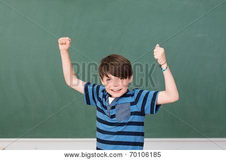 Handsome Young Schoolboy Celebrating