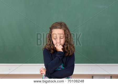 Worried Little Girl In School