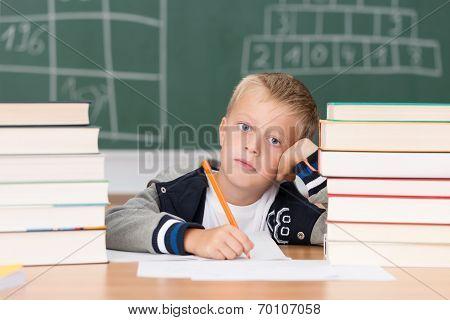 Dejected Little Boy In Class In School
