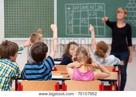 Young Boy Answering A Question In Class