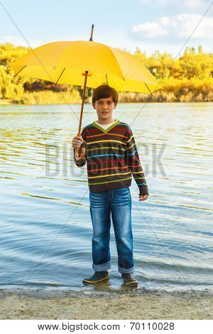 Boy in rainboots, standing in water