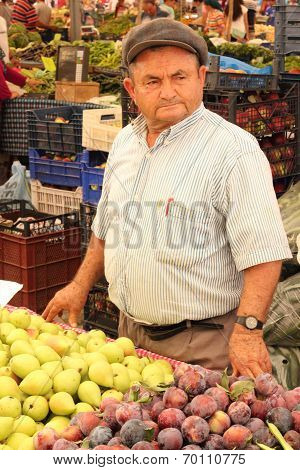 A local Turkish trader selling his fresh market produce