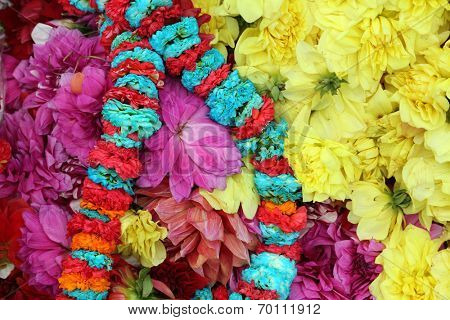 Flowers and garlands for sale at the flower market in the shadow of the Haora Bridge in Kolkata, West Bengal, India