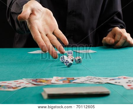 Man Throwing Dice On A Gambling Table