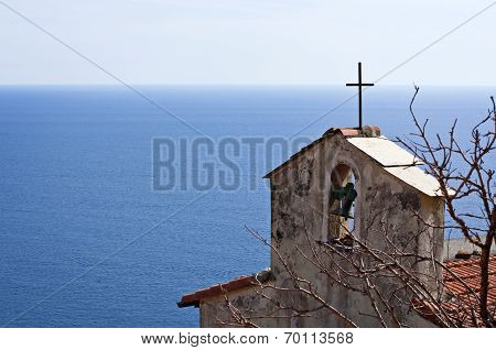 A bell tower, the sea and the sky