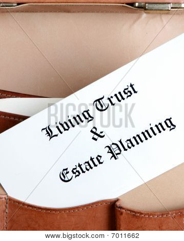 Estate Planning Documents In A Leather Briefcase - vertical