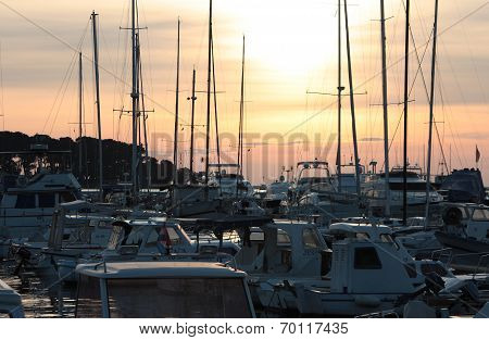Docked Yachts At Sunset Background
