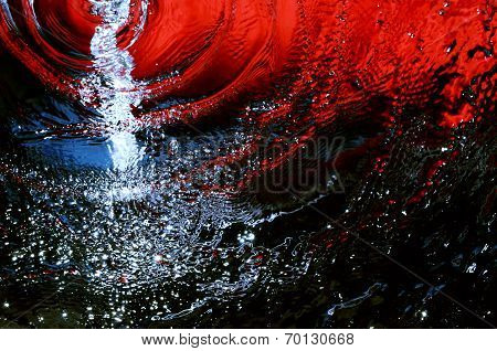 Water runs on a red-blue background