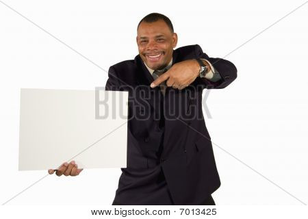 mature businessman pointing at a board