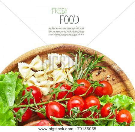 Fresh cherry tomatoes and salad in a wooden plate