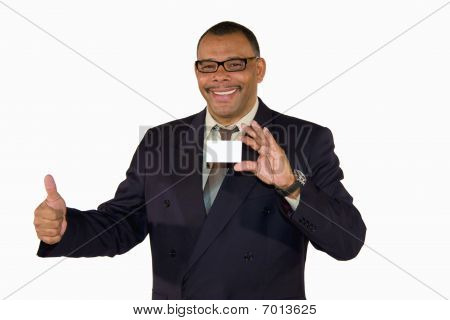 smiling mature businessman with card posing thumbs up