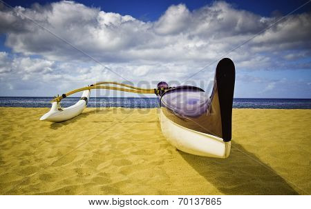 Purple and White canoe sitting on sand