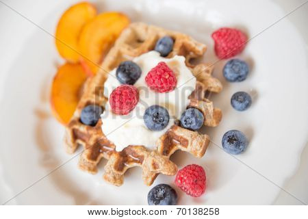 Waffles with clotted cream and berries