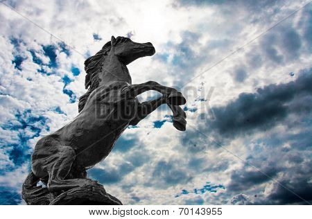 Statues Black Hourses On Sky Background