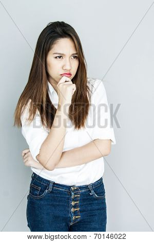 Potrait Asia Lady Mini Smile In Casual Suite White Shirt And Blue Jeans Thinking Concept