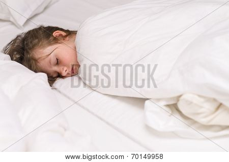 Cute Little Girl Fast Asleep In Bed