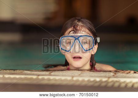 Pretty Little Girl Wearing Swimming Goggles