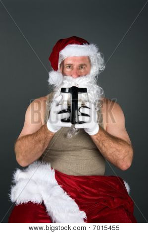Santa Drinking A Pot Of Coffee