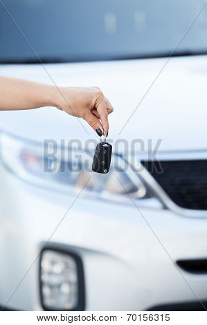 Female Hand Holding Car Key With Pov On Background