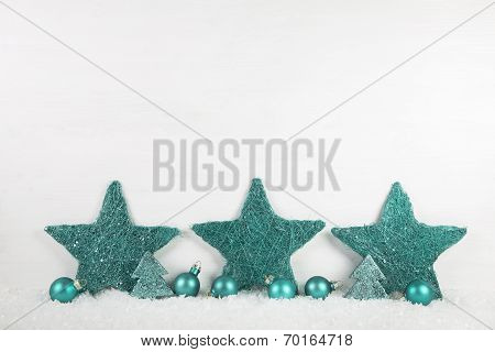 Wooden White Christmas Background With Mint Green Stars.
