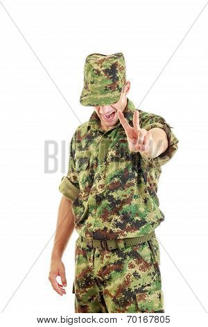 Angry Soldier With Hidden Face In Green Camouflage Uniform And Hat Yelling