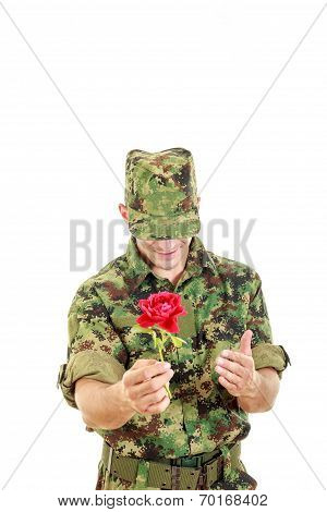Military Officer Holding Flower Smiling Shy With Head Bowed