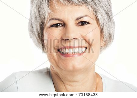 Portrait of a senior woman smiling, isolated on white