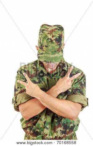 No Name Soldier Standing With Sign Of Peace With Cross Arms